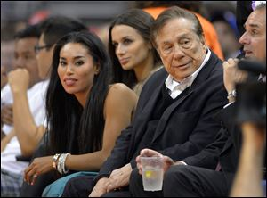 Los Angeles Clippers owner Donald Sterling, right, and V. Stiviano, left, watch the Clippers play in October.