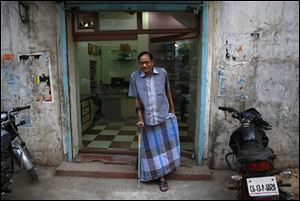 India's Ramesh Agrawal walks outside his shop during an interview in Raigarh in Chhattisgarh state, India. Six environmental advocates from India, Peru, Russia and three other nations have won this year's Goldman Prize, which is awarded annually for grass-roots activism. Agrawal received the prize for helping villagers fight a large coal mine in Chhattisgarh state, the San Francisco-based Goldman Environmental Foundation said today.