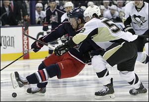 Boone Jenner, left, of Columbus is knocked down by Pittsburgh's Kris Letangoff. The Penguins won the series 4-2.
