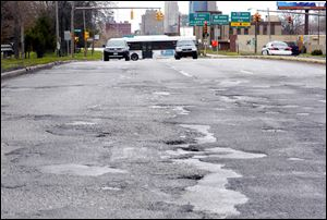 Southbound Anthony Wayne Trail near City Park Avenue is one part of the roadway in need of repair.