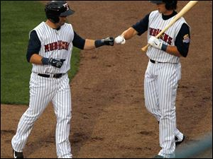 Toledo's Trevor Crow, left, is fist-bumped by a teammate after hitting his first home run in the second inning.