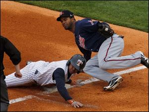 Toledo's Ezequiel Carrera is tagged out by Gwinnett's Edward Salcedo on a steal to third base during first inning.