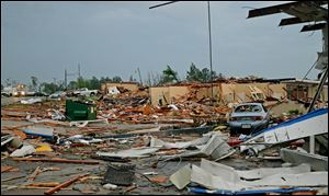 A damage building is seen in Tupelo, Miss. Monday. Tornados flattened homes and businesses, flipped trucks over on highways and injured numerous people in Mississippi and Alabama on Monday as a massive, dangerous storm system passed over several states in the South.