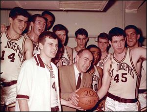 This undated photo provided by Saint Joseph's University shows the school's basketball coach Jack Ramsay, center, when his team won his 200th career game. Ramsay, a Hall of Fame coach who led the Portland Trail Blazers to the 1977 NBA championship before he became one of the league's most respected broadcasters, has died following a long battle with cancer. He was 89.