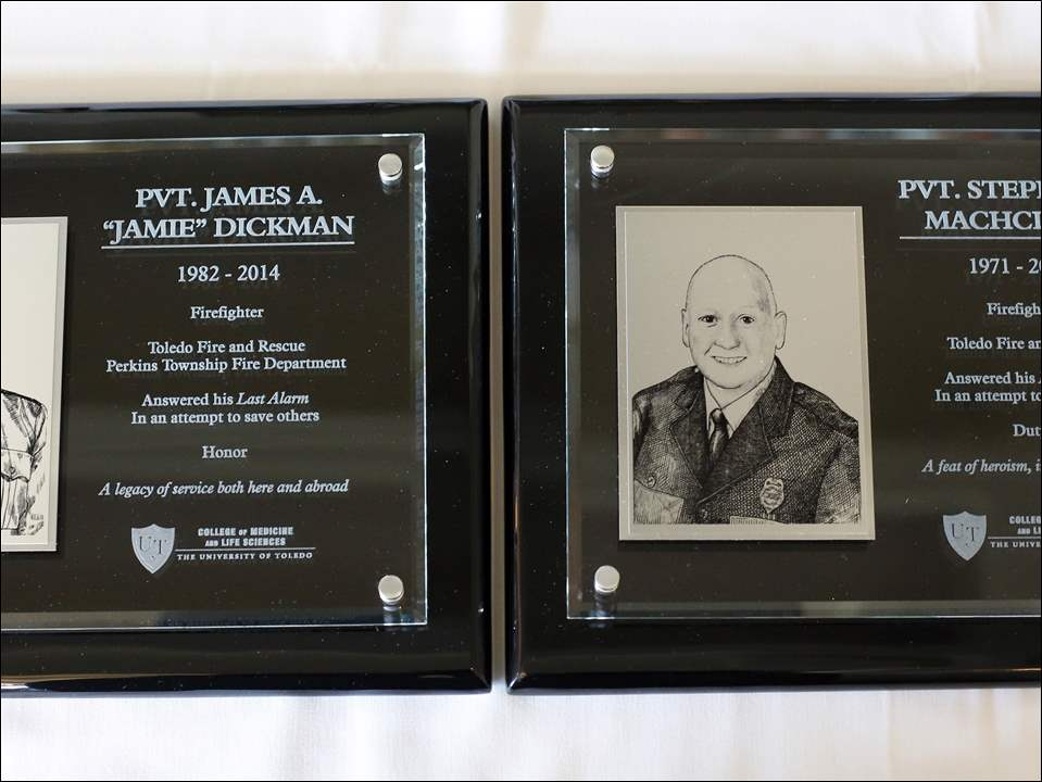 Plaques for Toledo firefighters Jamie Dickman and Stephen Machcinski who were killed while fighting a fire earlier this year, were dedicated during the University of Toledo Emergency Medicine Wall of Honor ceremony today.