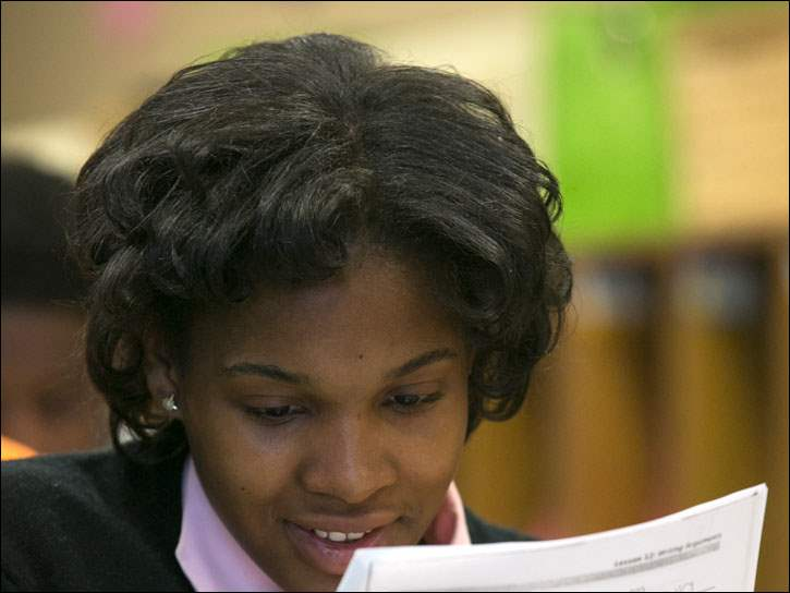 Eighth-grader Cylenthia Pickett looks over her work at Chase STEM Academy.