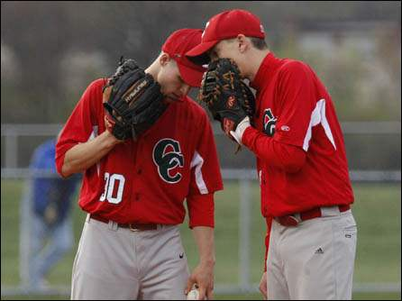 Central Catholic's pitcher Chad Kuebler, left, and first baseman Cameron Best meet on the mound against St. Francis