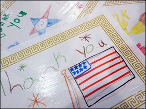 Artwork done by children is used as placemats during the breakfast before the Honor Flight.