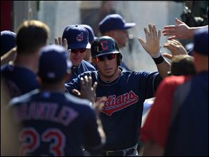Cleveland Indians' Asdrubal Cabrera is congratulated after scoring on a single by David Murphy.