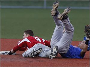 Central Catholic's Ryan O'Hearn is tagged out at 2nd base by St. Francis' Mark Phillips on an attempted steal