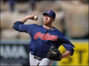 Cleveland Indians starting pitcher Zach McAllister throws to the plate during the first inning.