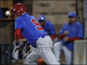 St. Francis' Nick Lankard bunts during the top of the 6th inning.