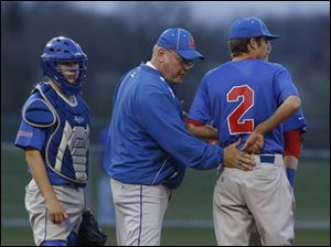 St. Francis coach Tim Gerken meets with pitcher Casey Johnson on the mound.