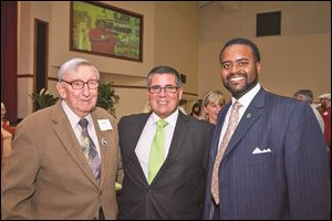 Andy Devine, Dan Rogers, CEO of Cherry Street Mission, and John Jones, board member at the fund-raiser.