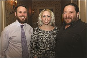 LeSo Art Gallery assistant director Bradley Scherzer, left, and co-owners Amber LeFever, center, and Adam Soboleski, attend the Passport to Hope event.