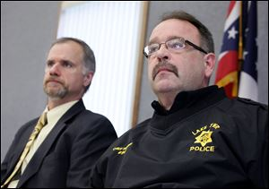 Wood County prosecutor Paul Dobson, left, and Lake Township Police Chief Mark Hummer talk during a news conference, in Millbury, Ohio, Wednesday, October, 17, 2012.
