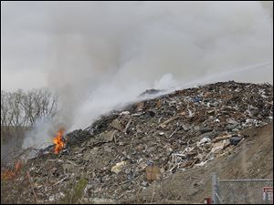 Toledo firefighters work on fire at a Stickney Recycling debris pile in Toledo.
