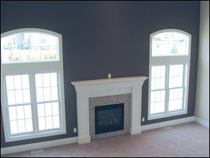 A beautiful fireplace is a focal point of the great room.