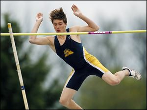 Austin Hanna of Whitmer clears the bar in the pole vault at St. Francis. He won the event to help lead the Panthers to the title.