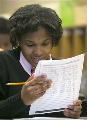 Chase eighth-grader Cylenthia Pickett looks over her work. Cylenthia was kicked out of school and arrested for fighting last year. She knew she did wrong. 'I thought I was big and bad.'