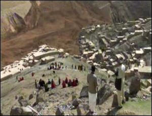 This image made from video shows people searching for survivors after a massive landslide landslide buried a village today in Badakhshan province, northeastern Afghanistan, which Afghan and U.N. officials say left hundreds of dead and missing missing.