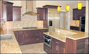 The kitchen features professional grade appliances, including an Electrolux gas cooktop and both a convection oven and a standard oven, and superior hard-ware.