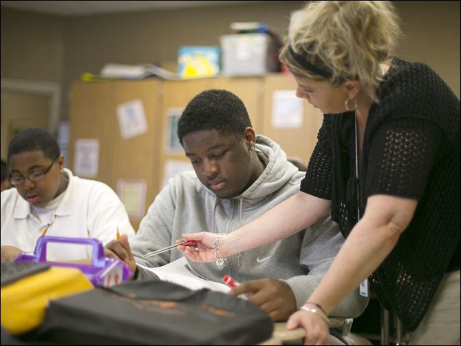 04n1discipline Teacher Tracey Johnson helps eighth-grader Demarko Craig prepare for an upcoming test at Chase STEM Academy. The school expelled Demarko last year for discipline problems. This year is different.