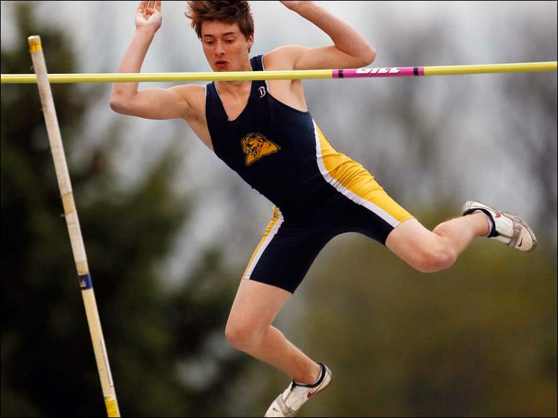 Austin Hanna of Whitmer competes in the pole vault.