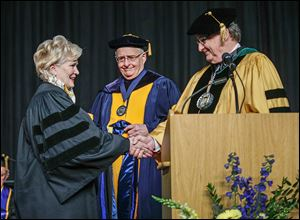 Commencement speaker Deborah L. Wince-Smith, president and CEO of the U.S. Council on Competitiveness, is bestowed an honorary doctorate in public administration degree from Joseph H. Zerbey IV, chairman of the university's Board of Trustees and president and general manager of The Blade, center, and Lloyd Jacobs, university president.