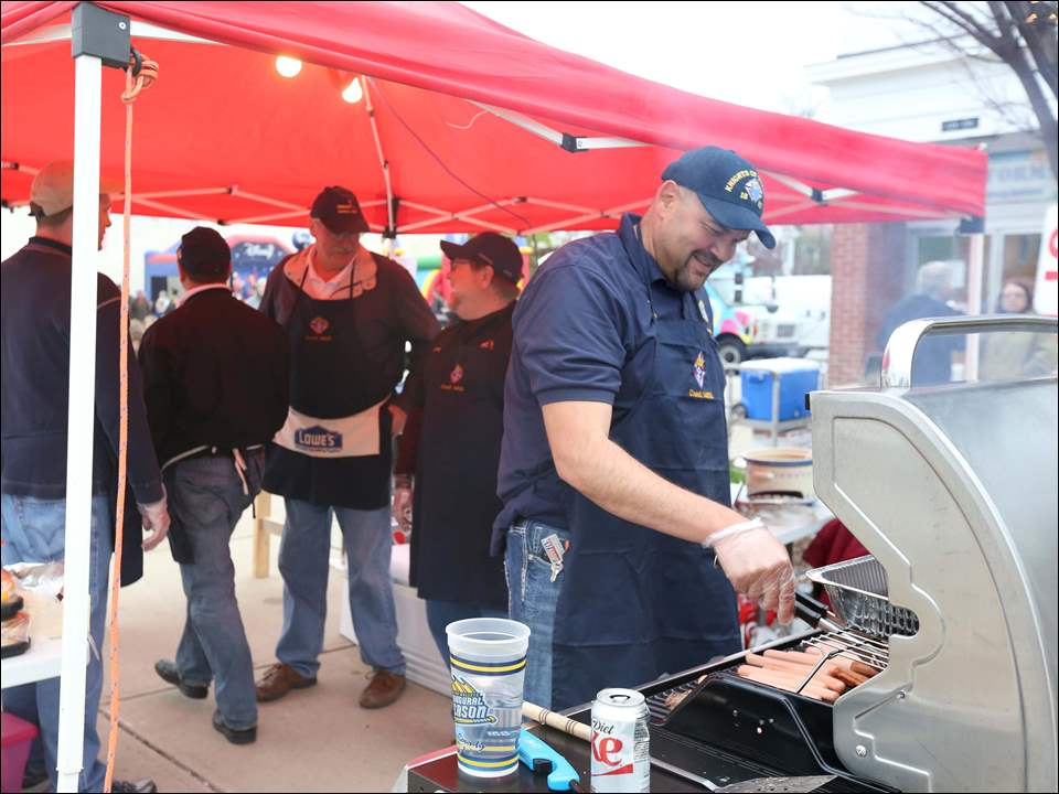Mike Feldkamp, of Perrysburg, right, manned the grill at the Knights of Columbus Saint John XXIII tent.