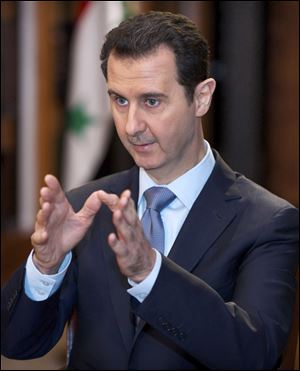 Bashar Assad, who is seeking a third seven-year term, will face Hassan bin Abdullah al-N