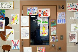 A door and surrounding walls on H Block in the Lucas County Juvenile Detention Center are covered with the art created by student inmates.