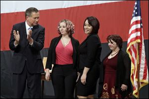 Ohio Gov. John Kasich, from left, introducing Amanda Berry, Gina DeJesus and Michelle Knight during his State of the State address in February at the Performing Arts Center in Medina, Ohio.