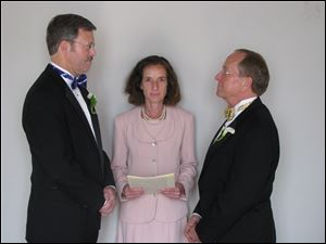 Mark Andrew, left, and Bishop V. Gene Robinson are shown during their private civil union ceremony performed by Ronna Wise in Concord, N.H., in this 2008 file photo.
