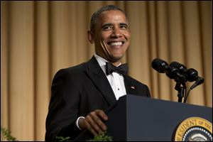 President Barack Obama smiles while making a joke during his speech at the White House Correspondents' Association Dinner Saturday at the Washington Hilton Hotel.
