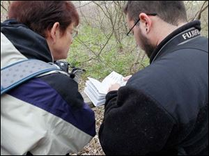 Donna Kayne Owen, of Lyndhurst, Ohio, left, and Daniel Parsons, of Anchorage, use a book to help them to identify a bird.