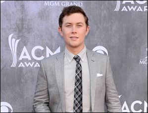 Police say Scotty McCreery was the victim of an early morning home invasion near the campus of North Carolina State University, where he is a student.