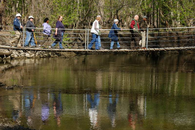 Birders-cross-a-bridge