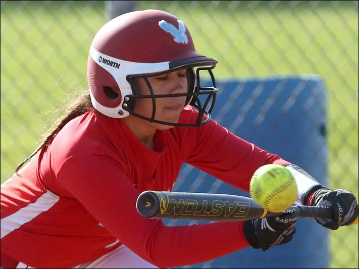 Eastwood's Caitlan Clay bunts in the bottom of the fifth inning.