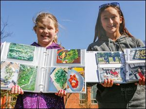 5th graders Lauren Hitts, left, and Maria Richard show the fruits of their gardening labor.