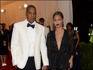Jay Z, left, and Beyonce
