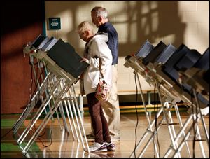 Sue and John Fitzgerald cast their ballots on primary election day, at the polling place inside Beverly Elementary School in South Toledo.