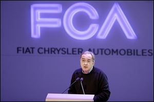 Chrysler Group LLC Chairman and CEO Sergio Marchionne speaks to investors Tuesday at the automaker's world headquarters in Auburn Hills, Mich. about its plans as a combined entity.