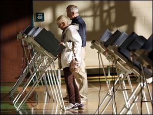 Sue and John Fitzgerald cast their ballots today at the polling place inside Beverly Elementary School.