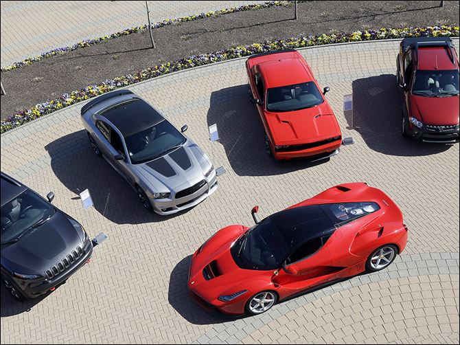 b4chrysler A LaFerrari is displayed alongside Fiat and Chrysler vehicles  in Auburn Hills, Mich. Fiat owns the Ferrari brand. Fiat Chrysler Automobiles'  plan includes investing big in re-establishing Alfa-Romeo.