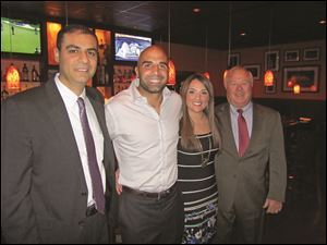At the Toledo Bar Association's Take a Lawyer to Dinner are, from left: Said Orra, Bruce Gradkowski, Sanaa Orra and Judge Jack Puffenberger.
