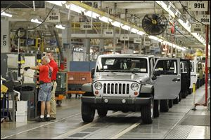 Jeep Wranglers roll off the assembly line at the Chrysler Toledo Assembly Complex. Fiat Chrysler Chief Executive Sergio Marchionne hinted that aluminum could be used to make future Wranglers.