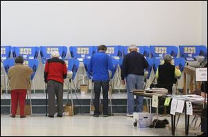 Voters cast their ballots at the Bulldog Center in Rossford.