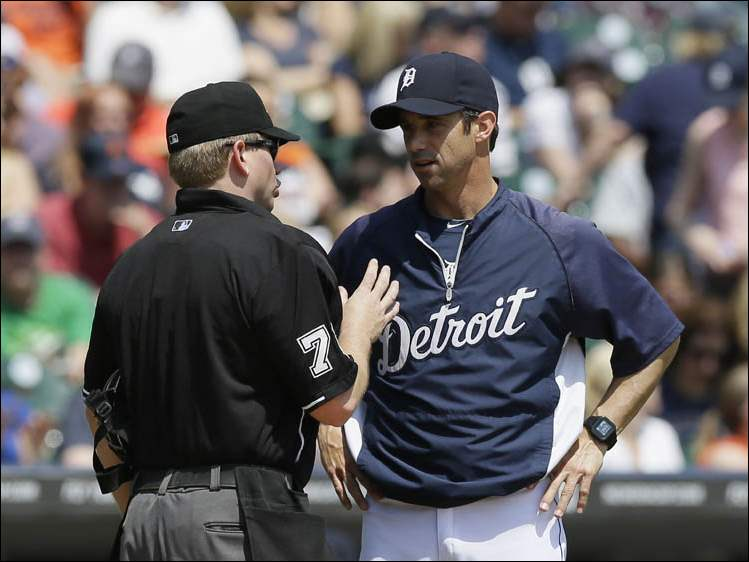 Homeplate umpire Mike Muchlinski talks with Detroit Tigers manager Brad Ausmus.