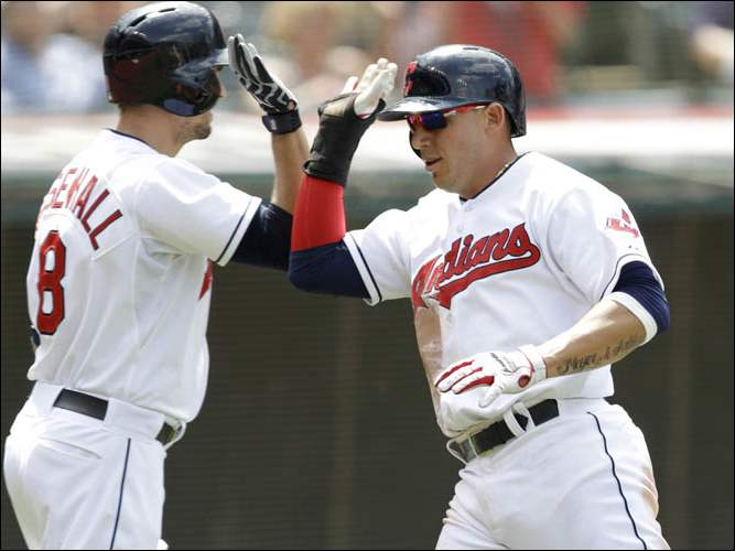 Cleveland Indians' Asdrubal Cabrera, right, is congratulated by Lonnie Chisenhall after Cabrera scored on an RBI-single by Ryan Raburn.